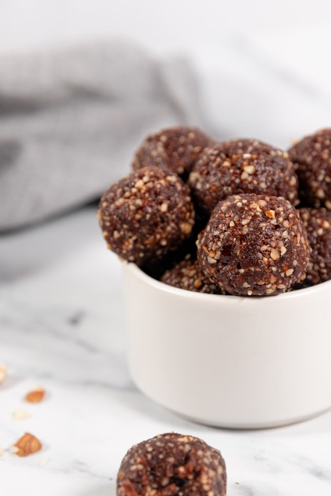 Close-up shot of a bowl with some energy balls in it