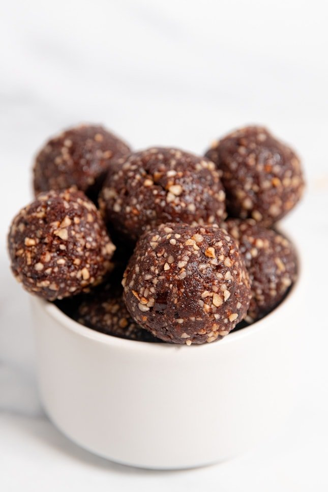 Photo of a bowl with some energy balls in it