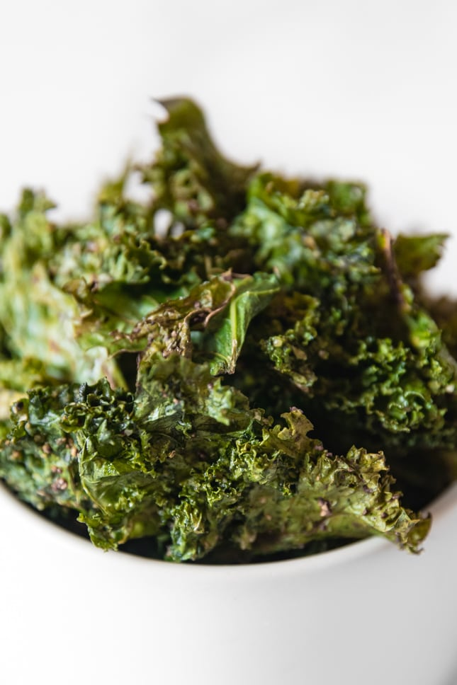 Close-up shot of a bowl of kale chips