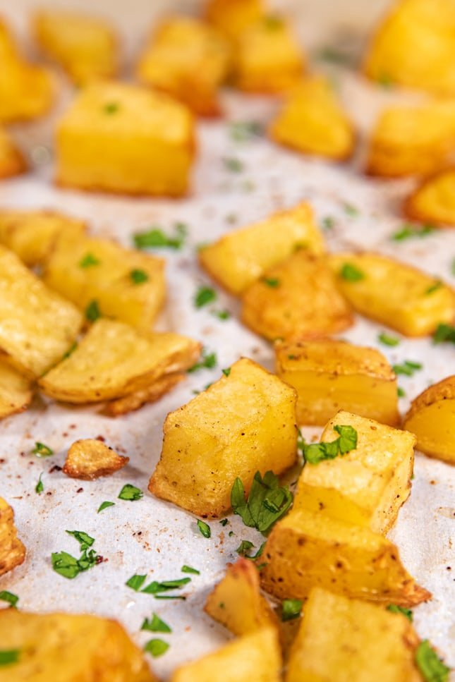 Close-up shot of a plate of roasted potatoes