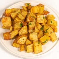 Square photo of a plate of roasted potatoes