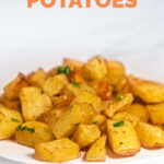 Side shot of a plate of roasted potatoes with the words roasted potatoes