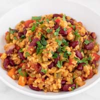 A square picture of a dish of vegan jambalaya