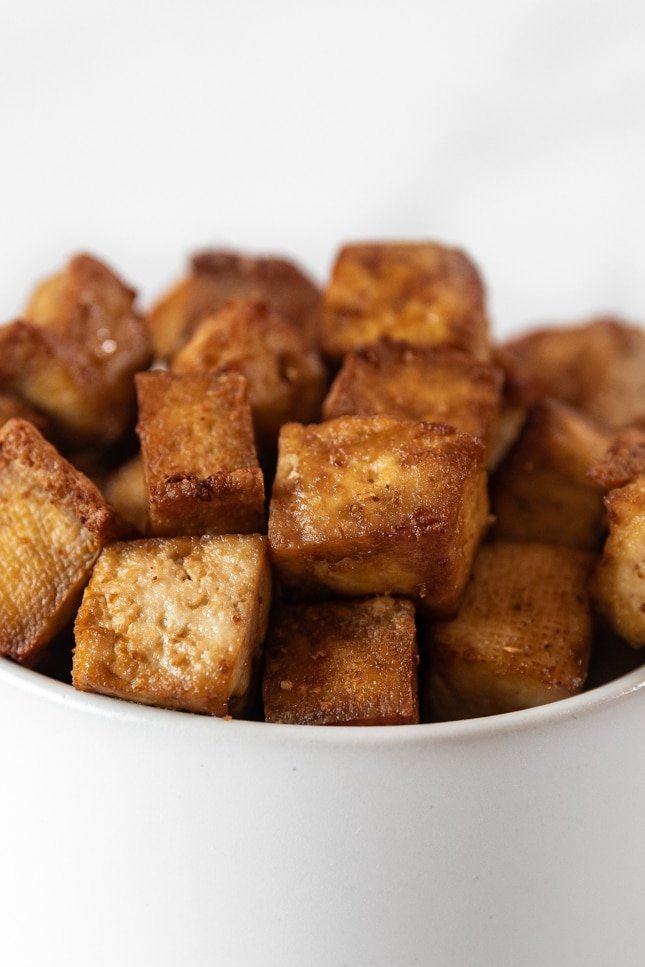 Close-up shot of a bowl of air fryer tofu