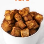 Photo of a bowl of air fryer tofu with the words air fryer tofu