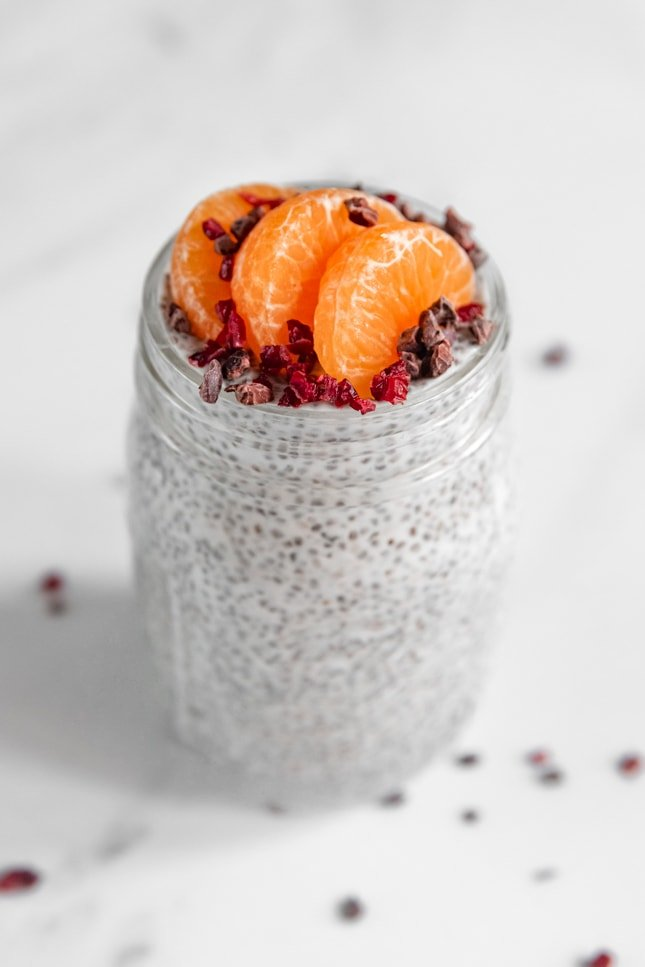 Photo of a glass jar of chia pudding