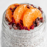 Close-up shot of a glass jar of chia pudding with the words chia pudding