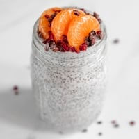 Square photo of a glass jar of chia pudding