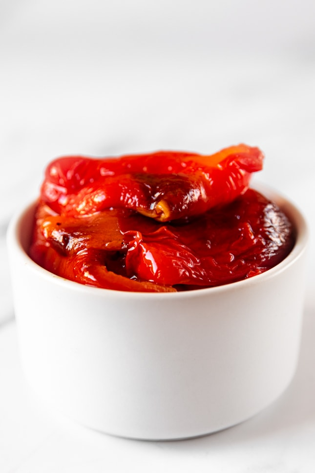 Close-up shot of a bowl of roasted red peppers