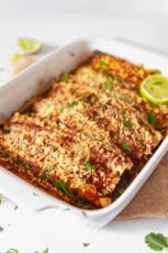 Photo of a baking dish with homemade vegan enchiladas