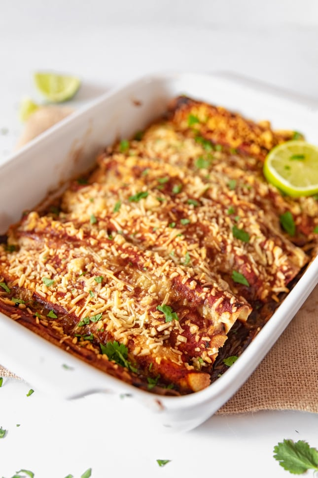 Photo of a baking dish with vegan enchiladas