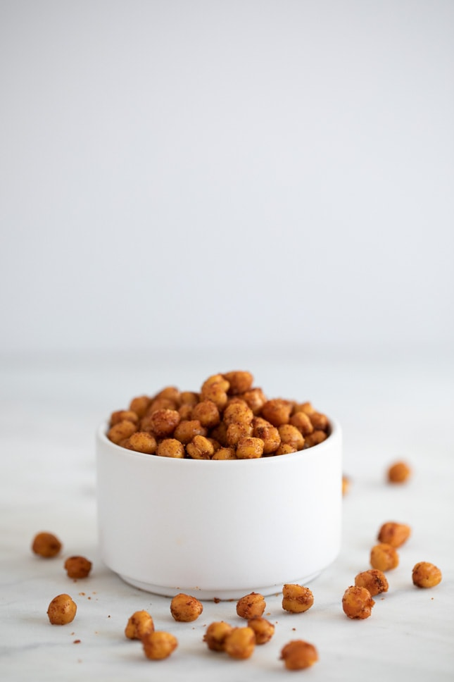 Side shot of a container with homemade roasted chickpeas