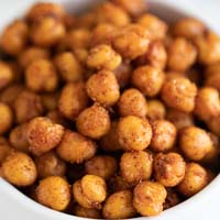 A square photo of a bowl with roasted chickpeas