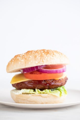 A side shot of a dish with a homemade vegan burger