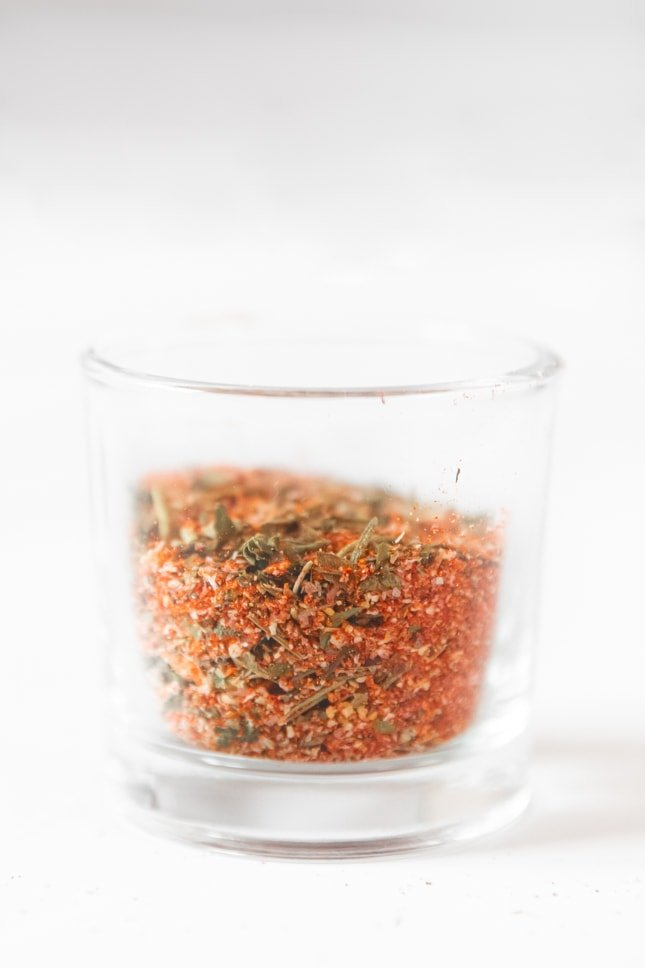 Side shot of a glass jar of chicken seasoning