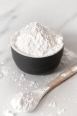 Photo of a bowl and a spoonful of homemade powdered sugar