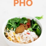 A picture of a bowl with homemade vegan pho with the words vegan pho