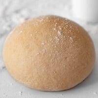 Square photo of a homemade pizza dough