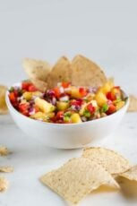 A picture of a bowl of pineapple salsa with nachos