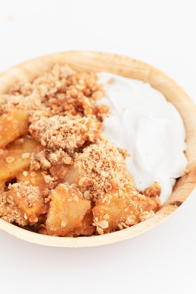 Photo of a bowl of vegan apple crisp