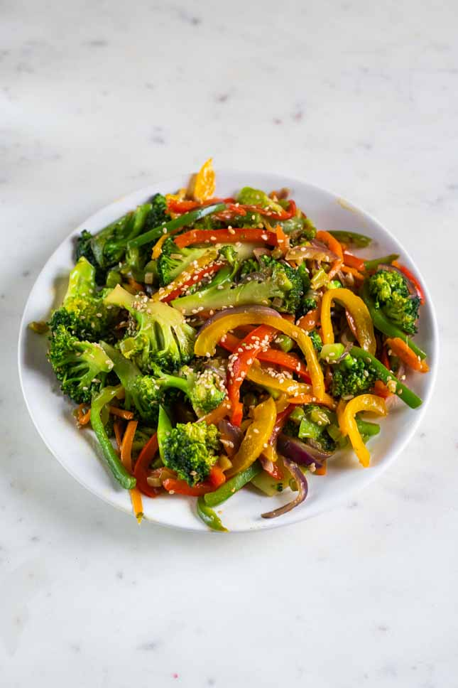 A picture of a dish with veggie stir fry made from scratch