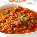 CLose-up shot of a bowl of lentil soup with the words lentil soup