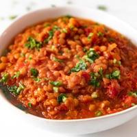 Square photo of a bowl of lentil soup