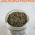 A close shot of a glass jar with homemade Italian seasoning with the words Italian seasoning