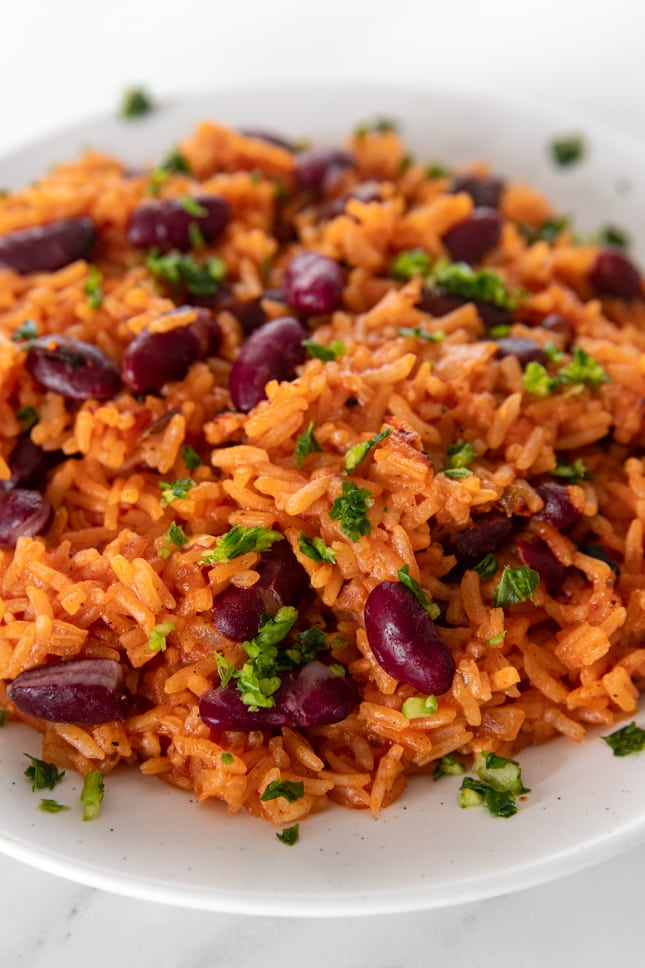Close-up shot of a plate of Spanish rice and beans