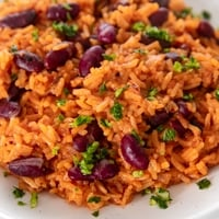 Square photo of a plate of Spanish rice and beans