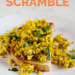 A picture of a dish with some toasts with tofu scramble and chopped parsley and the words tofu scramble