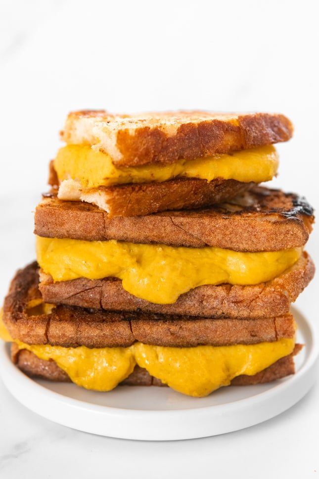 Photo of a pile of sandwiches with some vegan grilled cheese