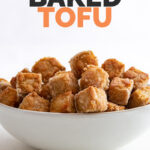 Side shot of a bowl of baked tofu with the words baked tofu