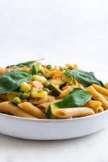 Side photo of a plate of pasta primavera