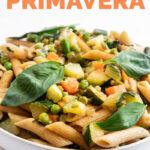 Close-up photo of a plate of pasta primavera with the words pasta primavera