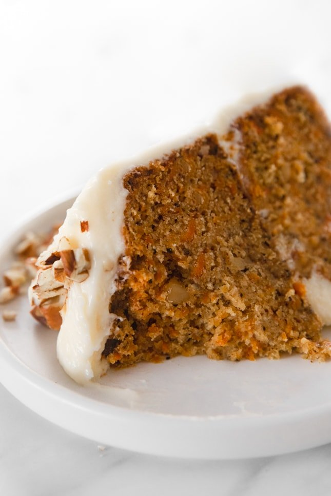 Close-up photo of a slice of vegan carrot cake