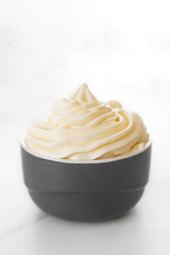 Side photo of a bowl of vegan cream cheese frosting