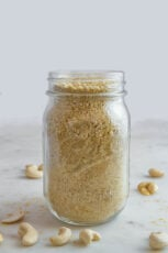 Side shot of a jar of vegan parmesan cheese