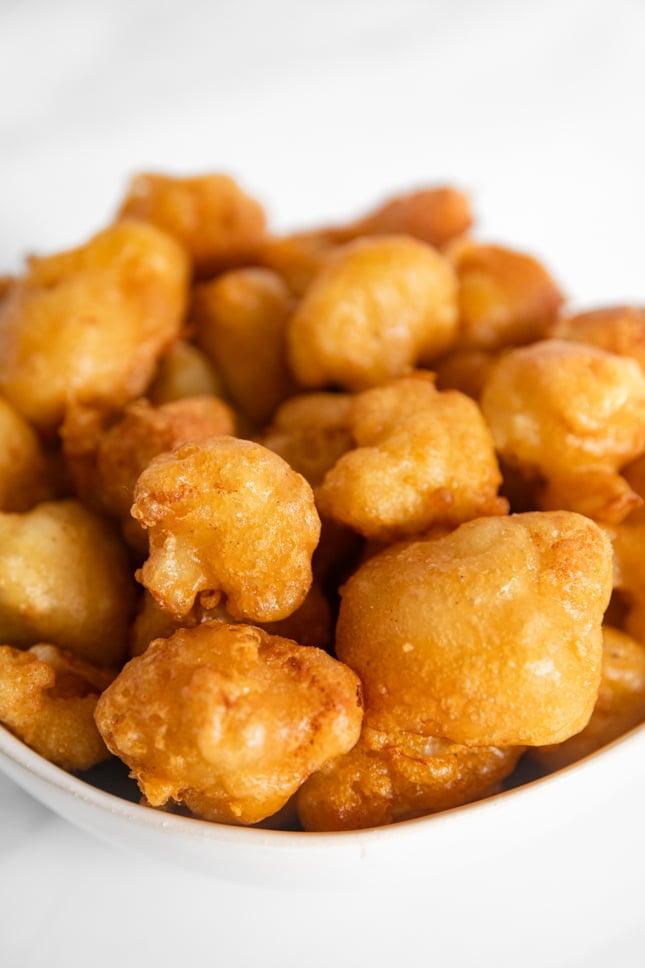 Close-up photo of a bowl of fried cauliflower
