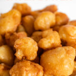 Photo of a bowl of fried cauliflower with the words fried cauliflower