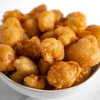 Square photo of a bowl of fried cauliflower