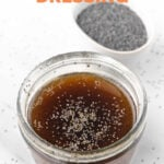 Photo of a glass jar of poppy seed dressing with the words poppy seed dressing