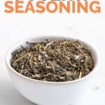 Photo of a bowl of poultry seasoning with the words poultry seasoning on top