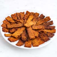 Square photo of a plate of tempeh bacon