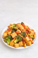 Photo of a plate of tofu stir fry with sesame seeds on top