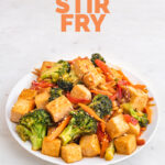 Photo of a plate of tofu stir fry with the words tofu stir fry