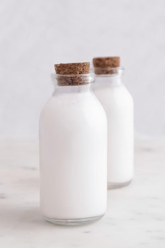 Photo of 2 glass bottles of coconut milk