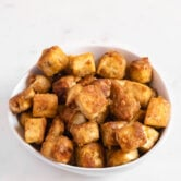 Photo of a bowl of cubed fried tofu