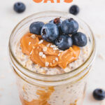 Close-up shot of a glass jar of overnight oats with the words overnight oats