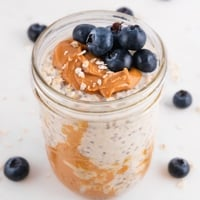 Square photo of a glass jar of overnight oats
